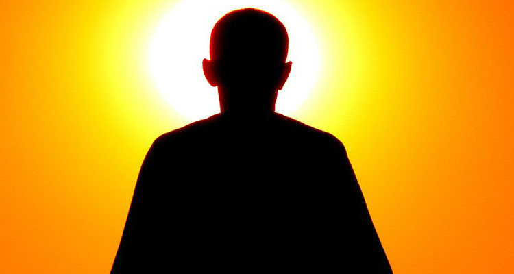 Man in front of sun